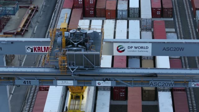 freight containers sit stacked by gantry cranes at dp world ltds london gateway deep sea port in stanford le hope, uk, on friday, may 16 high angle... - general view stock videos & royalty-free footage