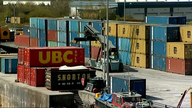 freight traffic along the manchester ship canal booms time lapse footage container ship being guided by tug into lock container ships passing with... - turbine stock videos & royalty-free footage