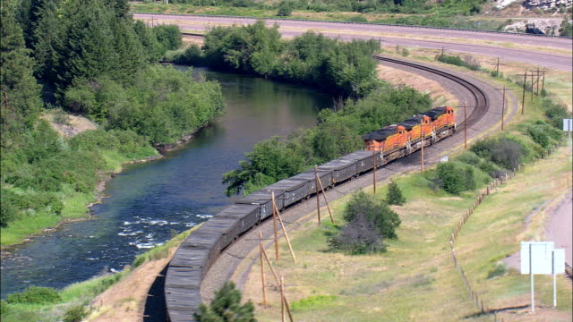 freight train   - aerial view - montana, granite county, united states - cargo train stock videos & royalty-free footage