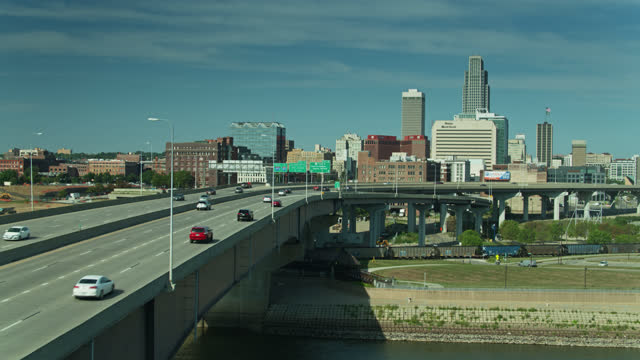 freight train and freeway bridge in downtown omaha - aerial - elevated road stock videos & royalty-free footage
