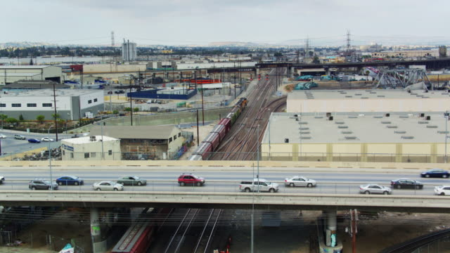 Freight Train and Traffic Overpass - Drone Shot