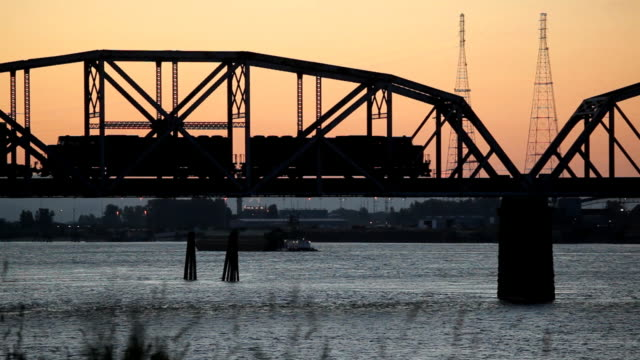 hd freight train crossing bridge at sunset - railway bridge stock videos & royalty-free footage