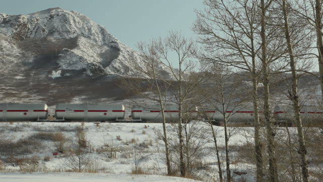 ws freight train crossing snowy landscape / inner mongolia, china - cargo train stock videos & royalty-free footage