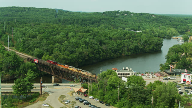 freight train crossing wisconsin river in wisconsin dells - aerial - street name sign stock videos & royalty-free footage