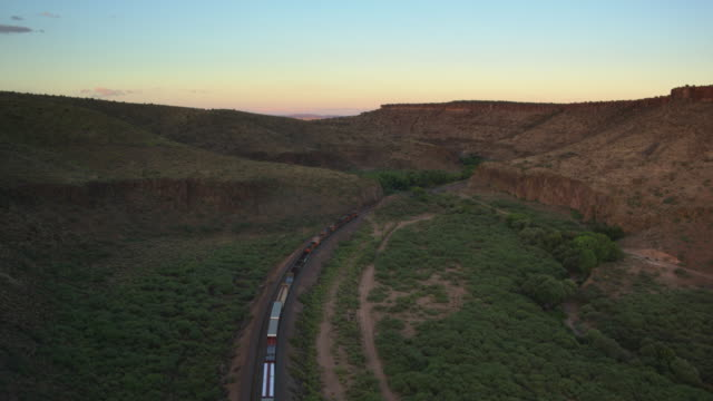 Freight Train Cutting Across Arizona - Drone Shot