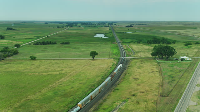 freight train in rural nebraska landscape - drone shot - nebraska stock videos & royalty-free footage