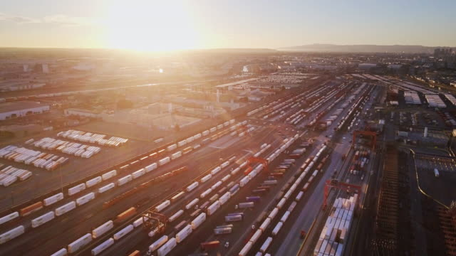 freight train intermodal yard at sunset - aerial shot - shunting yard stock videos and b-roll footage