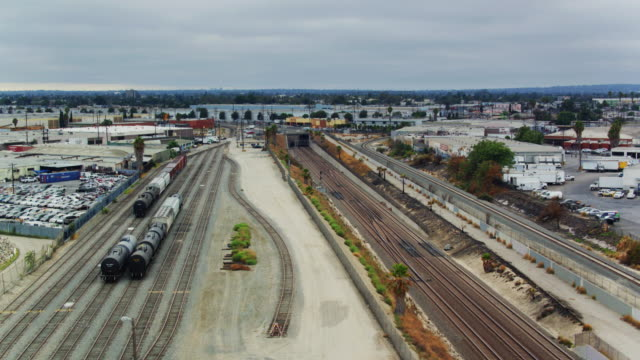 freight train lines in los angeles - drone shot - rail freight stock videos and b-roll footage
