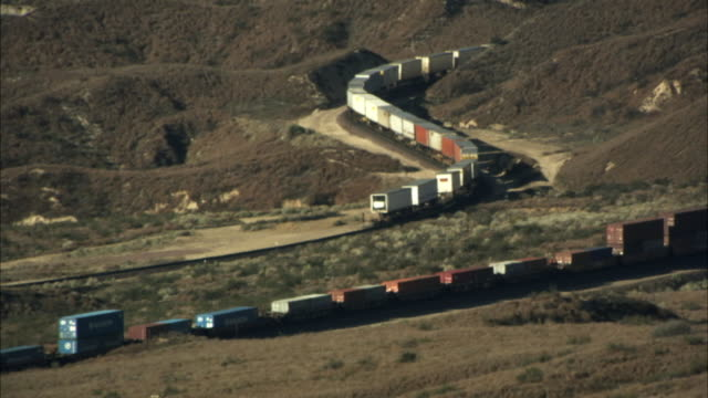 ws, ha, freight train loaded with coal moving slowly through mountains, california, usa - rail freight stock videos and b-roll footage