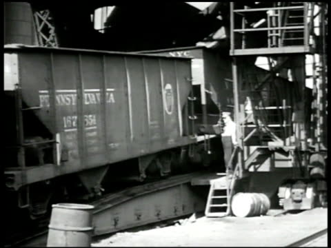 freight train moving by factory. train up ramp, worker, 'pennsylvania' on side. man signaling, climbing on train. train on elevator moving up. lift... - freight elevator stock videos & royalty-free footage