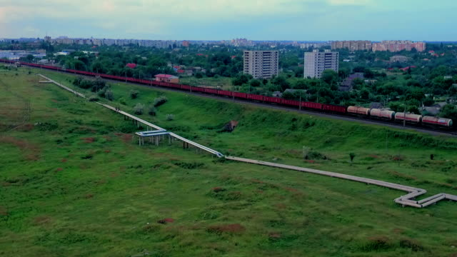 freight train moving near residential area - gas pipe stock videos and b-roll footage