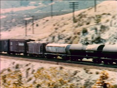 vídeos y material grabado en eventos de stock de 1954 pan freight train moving slowly on dry hillside / industrial - 1954