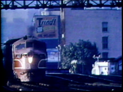 1973 montage pov freight train on tracks/ ha tu freight train with cityscape in background/ usa/ audio - anno 1973 video stock e b–roll