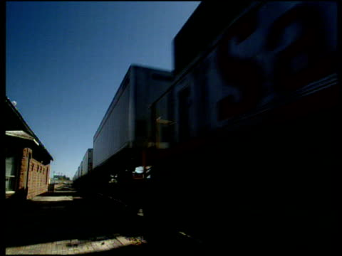 freight train passes level crossing through highway 140 on old route 66 new mexico. - level crossing stock videos & royalty-free footage