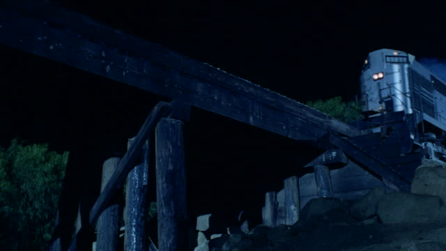 a freight train passes over a trestle. - c119gs点の映像素材/bロール