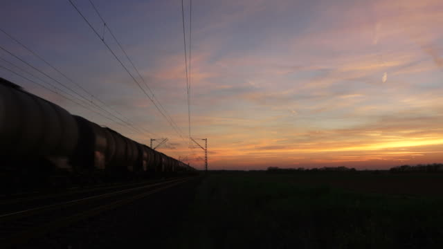 hd freight train passing by at dusk - cargo train stock videos & royalty-free footage