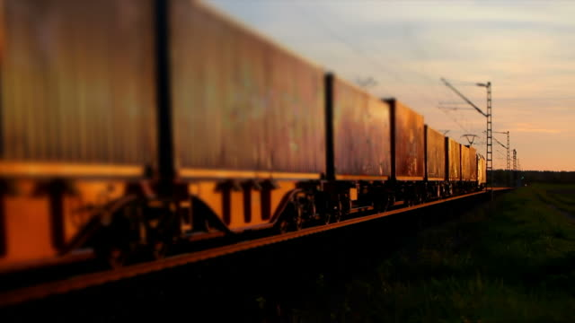 Freight Train Passing By At Sunset
