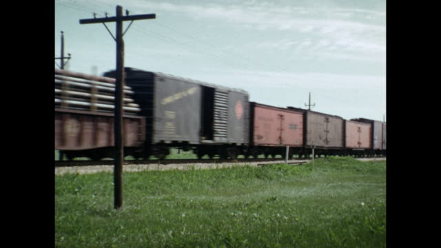 1954 home movie freight train passing by / united states - cargo train stock videos & royalty-free footage