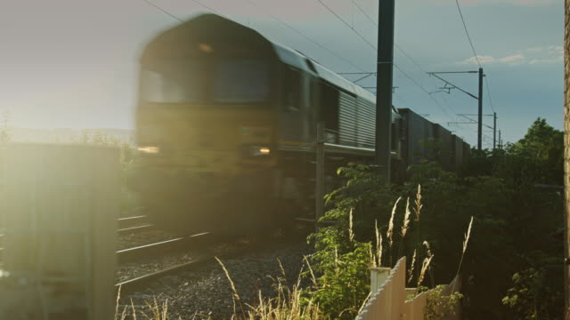 freight train passing camera - railroad track stock videos & royalty-free footage