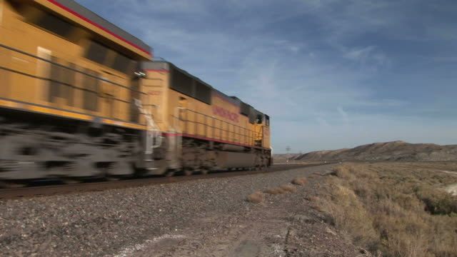 freight train passing in wyoming united states - c119gs stock videos & royalty-free footage