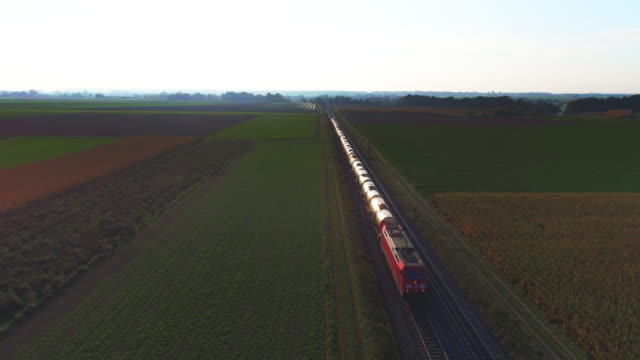 freight train passing through countryside in the afternoon - cargo train stock videos & royalty-free footage