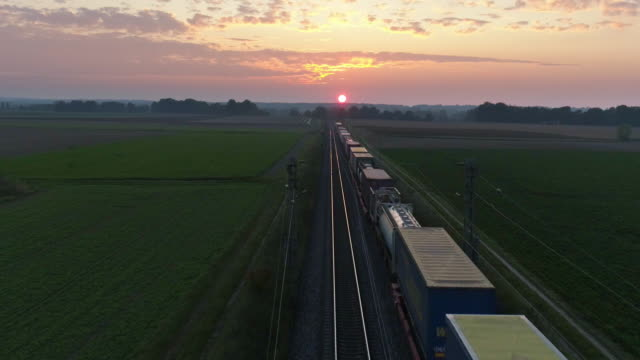 Freight Train Passing Through Countryside In The Afternoon