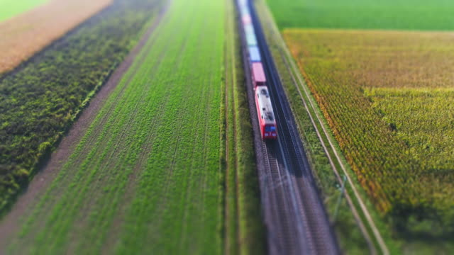 freight train passing through countryside - railroad track stock videos & royalty-free footage