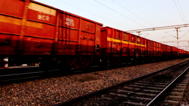 freight train passing through railroad station - cargo train stock videos & royalty-free footage
