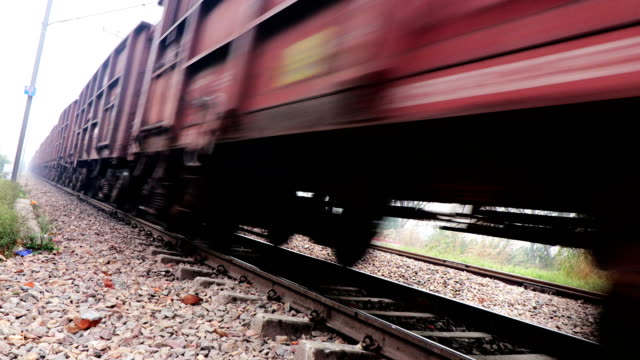 freight train passing through railroad station - railway track stock videos & royalty-free footage