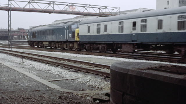 1973 montage freight train riding on the tracks through the city / nottingham, england, united kingdom - 1973 stock videos & royalty-free footage