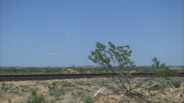 MS, PAN freight train riding through desert