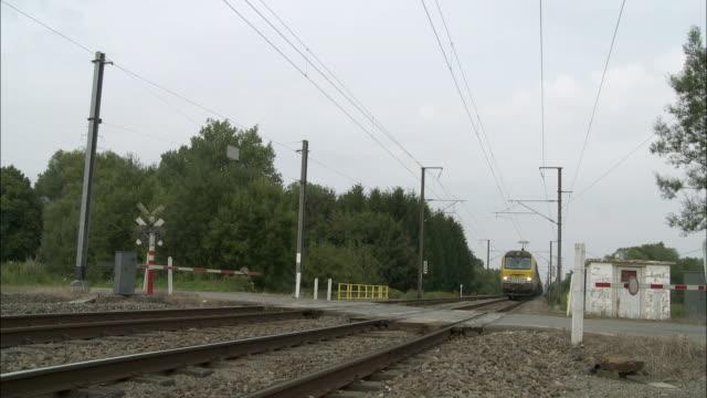 CU Freight train riding through railroad crossing, St. Remy, Belgium