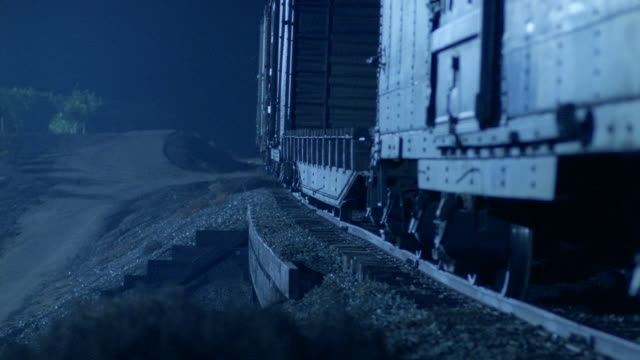 a freight train rumbles slowly across a trestle. - c119gs点の映像素材/bロール