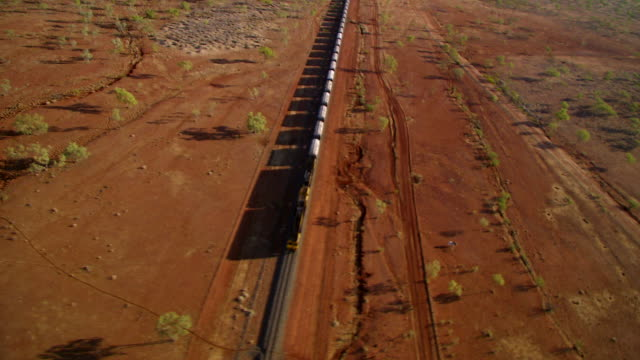 ws aerial freight train running on track and landscape with trees / cloncurry, queensland, australia - cargo train stock videos & royalty-free footage