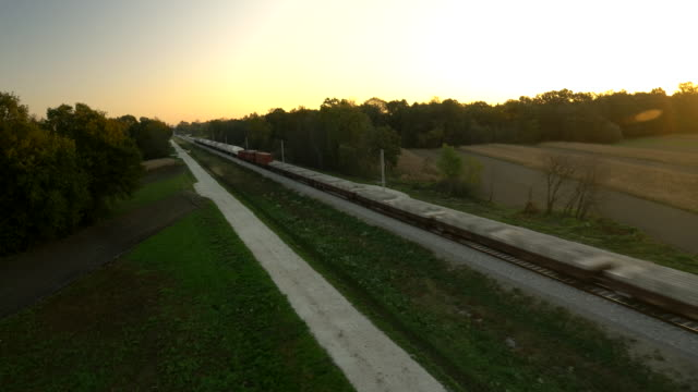 aerial freight train traveling through countryside - moving past stock videos & royalty-free footage
