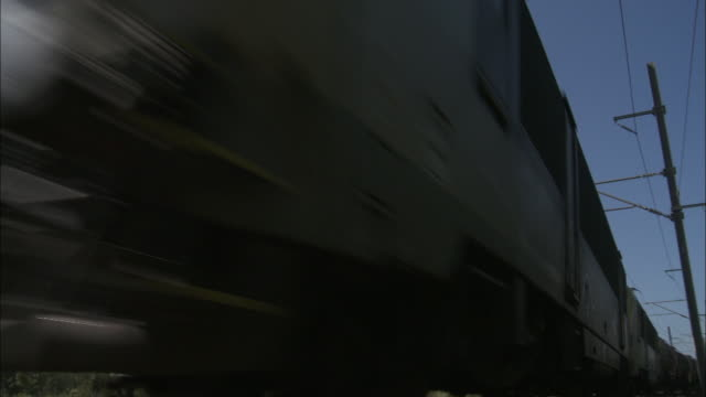 a freight train travels through the belgium countryside. - belgium stock videos & royalty-free footage