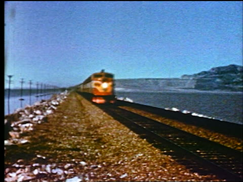 1947 freight train with diesel engine moving past camera / educational - 1947年点の映像素材/bロール