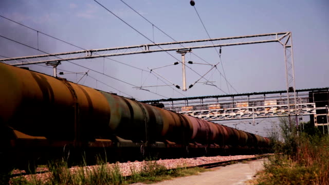 freight train with petroleum tank cars passing - diesel fuel stock videos and b-roll footage