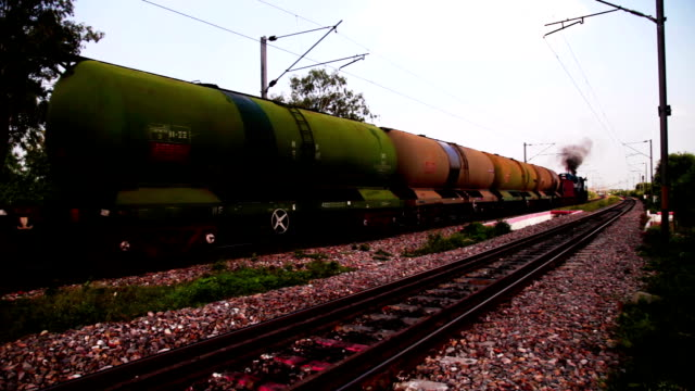 freight train with petroleum tank cars passing - fuel storage tank stock videos and b-roll footage