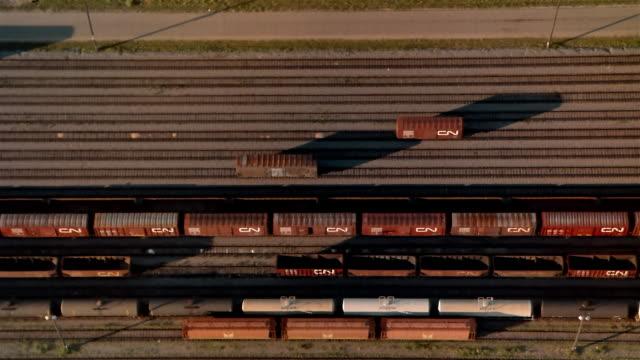 aerial, freight trains on train yard, british columbia, canada  - 操車場点の映像素材/bロール