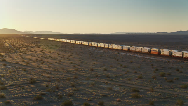 freight trains passing - drone shot - container stock videos & royalty-free footage