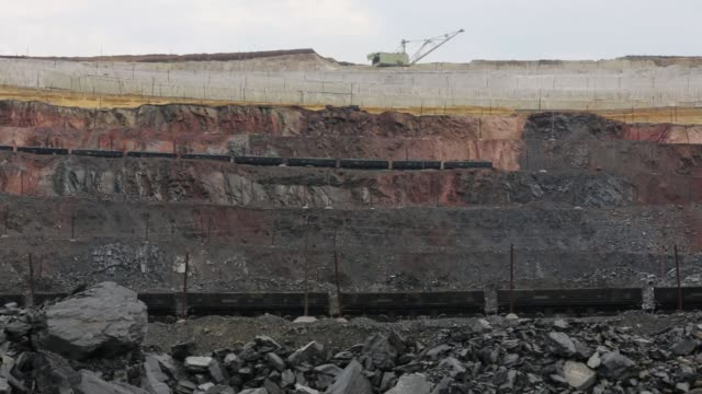Freight trains transport iron ore from the Lebedinsky GOK iron ore mining and processing plant operated by METALLOINVEST Holding Company OAO in...