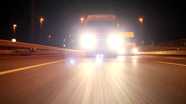 freight transportation at night ,rear view - headlight stock videos & royalty-free footage