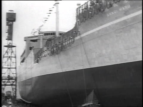 vídeos de stock, filmes e b-roll de freighter akagi maru launching by mrs. ridgway with general ridgeway looking on / yokohama, japan - 1951