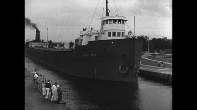 freighter in dock ws freighter passing soo locks in soo canal lake superior - lago superiore video stock e b–roll