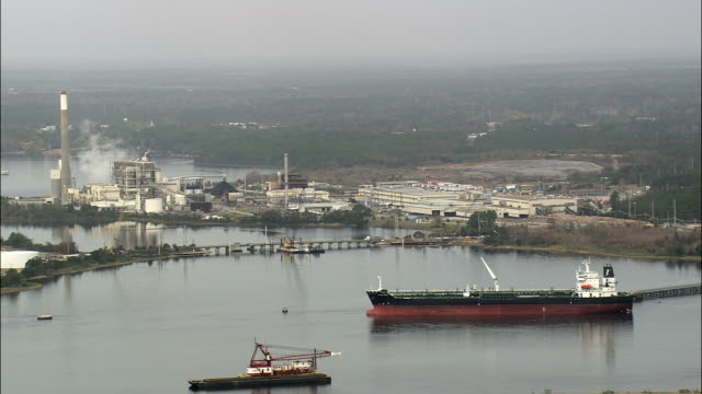 freighter on st johns river - aerial view - georgia,  ware county,  united states - jacksonville florida stock videos and b-roll footage