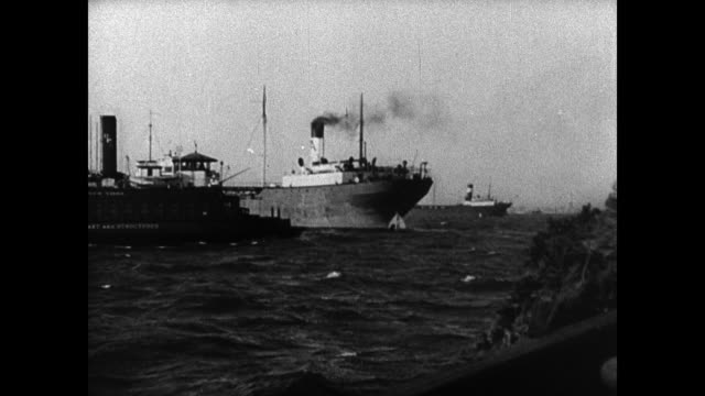 freighter ship in new york city harbor. motorcycle escort on street, crowds . president franklin 'fdr' roosevelt riding in convertible car waving to... - 1936 stock videos & royalty-free footage
