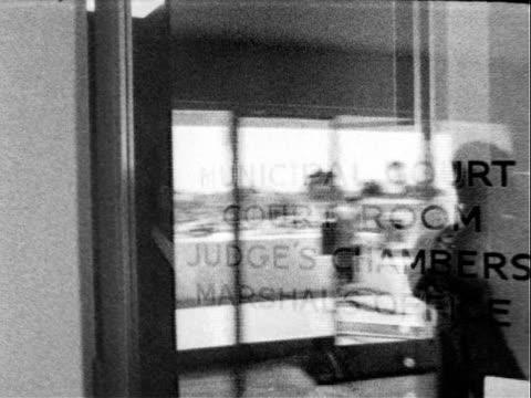 vídeos y material grabado en eventos de stock de french actor jeanpierre aumont and italian actress marisa pavan grinning from ear to ear while signing marriage papers at city hall / mr aumont and... - edificio de ayuntamiento local