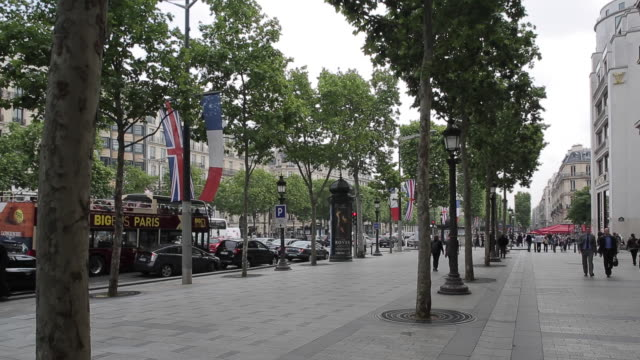 French and British Flags on Avenue des Champs Elysees, Paris, France, Europe