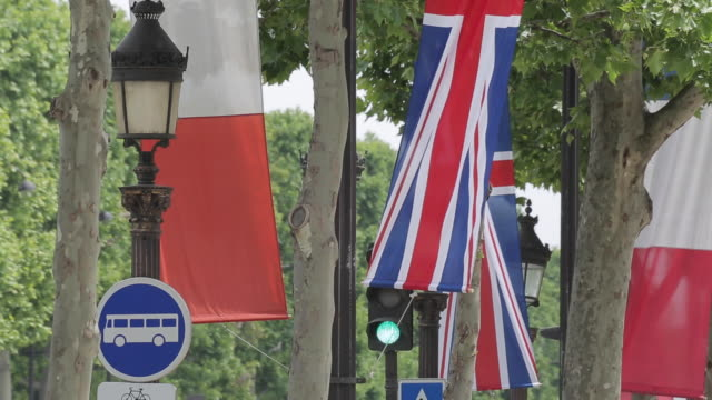 french and british flags on avenue des champs elysees, paris, france, europe - union jack stock videos & royalty-free footage